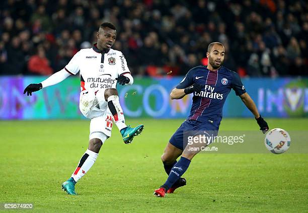 Jean Michael Seri of Nice and Lucas Moura of PSG in action during the French Ligue 1 match between Paris Saint Germain and OGC Nice at Parc des...