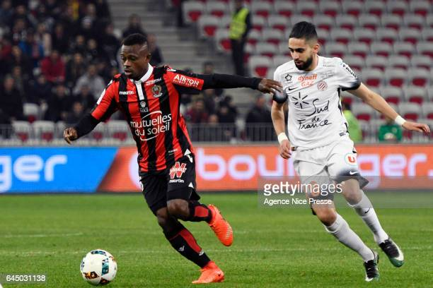 Jean Michael Seri of Nice and Ryad BOUDEBOUZ of Montpellier during the French Ligue 1 match between Nice and Montpellier on February 24 2017 in Nice...
