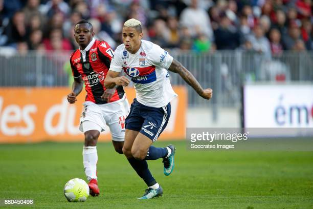 Jean Michael Seri of Nice Mariano Diaz of Olympique Lyon during the French League 1 match between Nice v Olympique Lyon at the Allianz Riviera on...