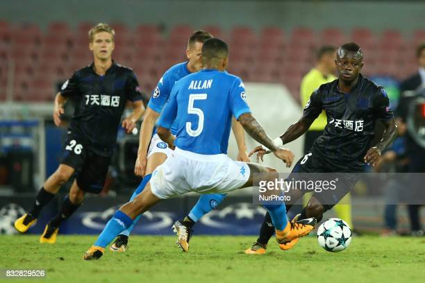 Jean Michael Seri of Nice vies Allan of SSC Napoli during the UEFA Champions League Play Off first leg football match SSC Napoli vs OCG Nice on...