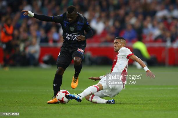 Jean Michael Seri of OGC Nice and Hakim Ziyech of Ajax during the UEFA Champions League Qualifying Third Round match between Ajax and OSC Nice at...