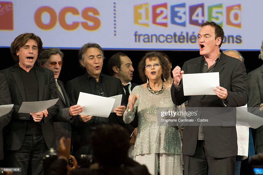 Jean Michel Jarre, Daniel Auteuil, Richard Berry, Patrick Timsit, Claudia Cardinale and Quentin Tarantino on stage during the Tribute to Jean Paul Belmondo and Opening Ceremony of the Fifth Lumiere Film Festival, in Lyon.