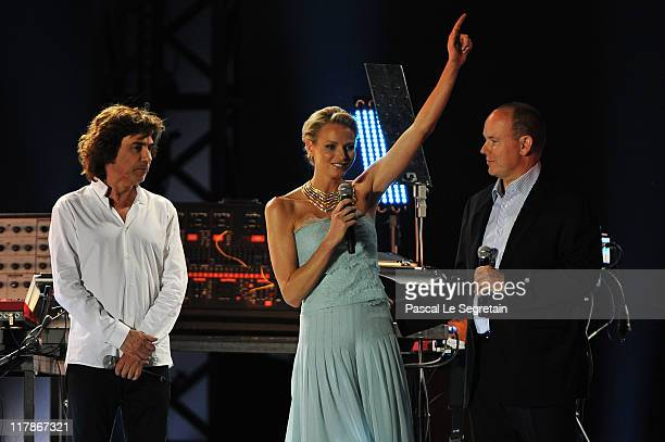 Jean Michel Jarre Princess Charlene of Monaco and Prince Albert II of Monaco appear onstage during the Jean Michel Jarre concert celebrating the...