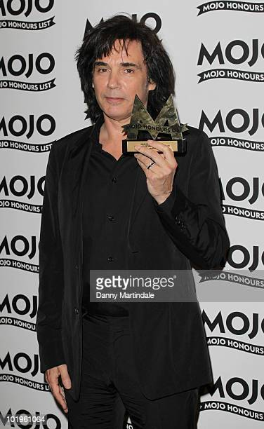 Jean Michel Jarre with award at The Mojo Honours List at The Brewery on June 10 2010 in London England