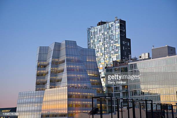 Jean Nouvel's curving curtain wall of different sized panes of colorless glass, each set in a unique angle and torque, of residential tower at West Side Highway and 19th Street and IAC global headquarters building withs glass facade along the West Side Hi