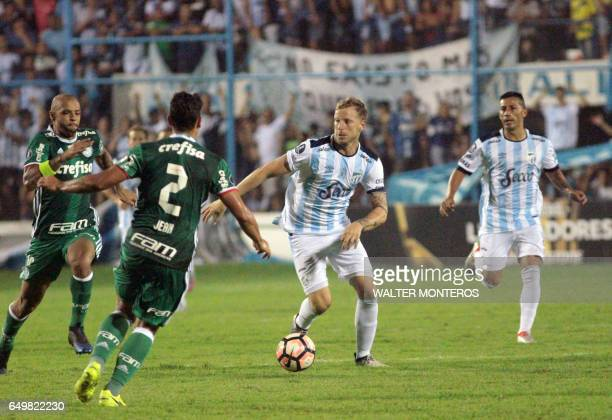 Jean of Brazil's Palmeiras vies for the ball with Cristian Menendez of Argentina's Atletico Tucuman during their Copa Libertadores football match in...