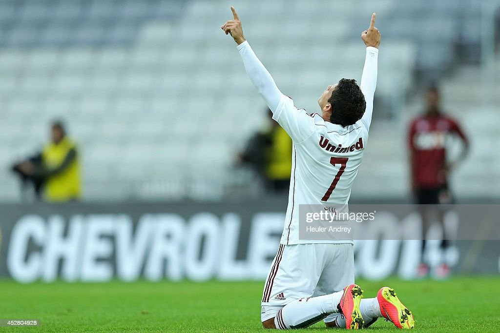 Jean of Fluminense celebrates a goal during the match between Atletico-PR and Fluminense for the Brazilian Series A 2014 at Arena da Baixada on July 27, 2014 in Curitiba, Brazil.