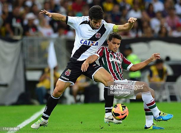 Jean of Fluminense struggles for the ball with Juninho of Vasco during a match between Fluminense and Vasco as part of Brazilian Championship 2013 at...