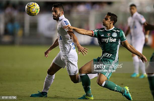 Jean of Palmeiras fights for the ball with Thiago Maia of Santos during the match between Santos and Palmeiras for the Brazilian Series A 2016 at...