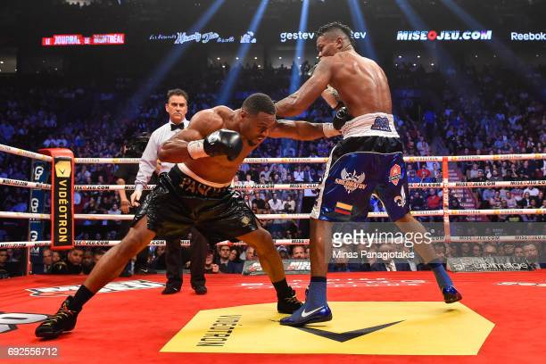 Jean Pascal connects with a body blow against Eleider Alvarez during the WBC light heavyweight silver championship match at the Bell Centre on June 3...