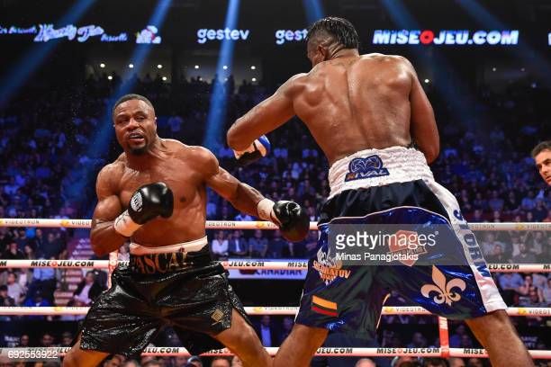 Jean Pascal defends himself against Eleider Alvarez during the WBC light heavyweight silver championship match at the Bell Centre on June 3 2017 in...