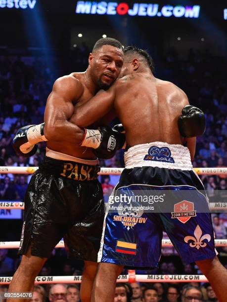 Jean Pascal locks up with Eleider Alvarez during the WBC light heavyweight silver championship match at the Bell Centre on June 3 2017 in Montreal...