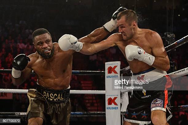 Jean Pascal of Canada throws a punch towards Sergey Kovalev of Russia during the WBO WBA and IBF light heavyweight world championship match at the...