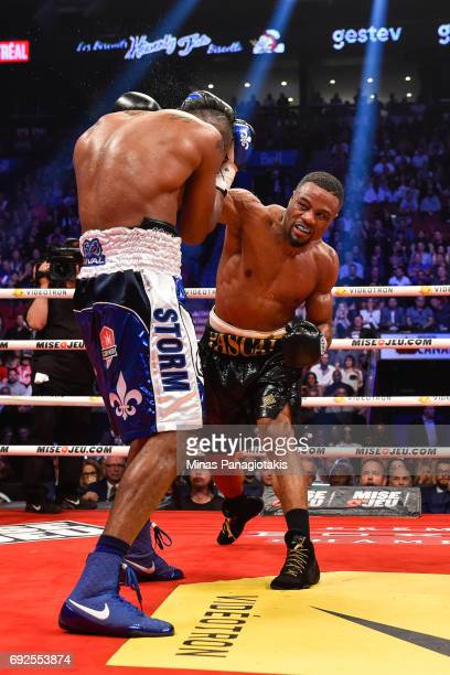 Jean Pascal punches Eleider Alvarez during the WBC light heavyweight silver championship match at the Bell Centre on June 3 2017 in Montreal Quebec...
