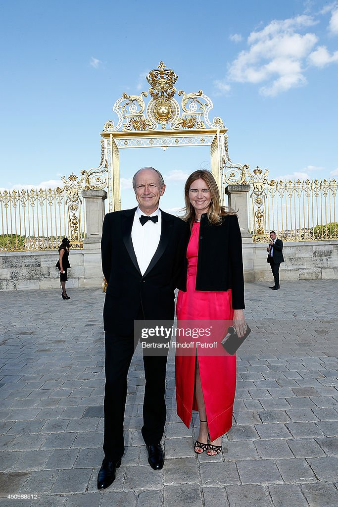 Jean Paul Agon, president of L'Oreal group and Sophie Schedecker arrive at the L'Oreal Gala Evening 2014 at Chateau de Versailles on June 20, 2014 in Versailles, France.