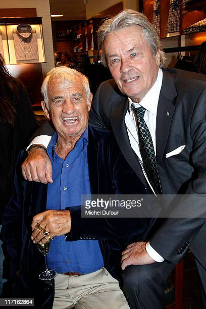 Jean Paul Belmondo and Alain Delon attend the Ermenegildo Zegna Flagship Opening In Paris on June 23 2011 in Paris France