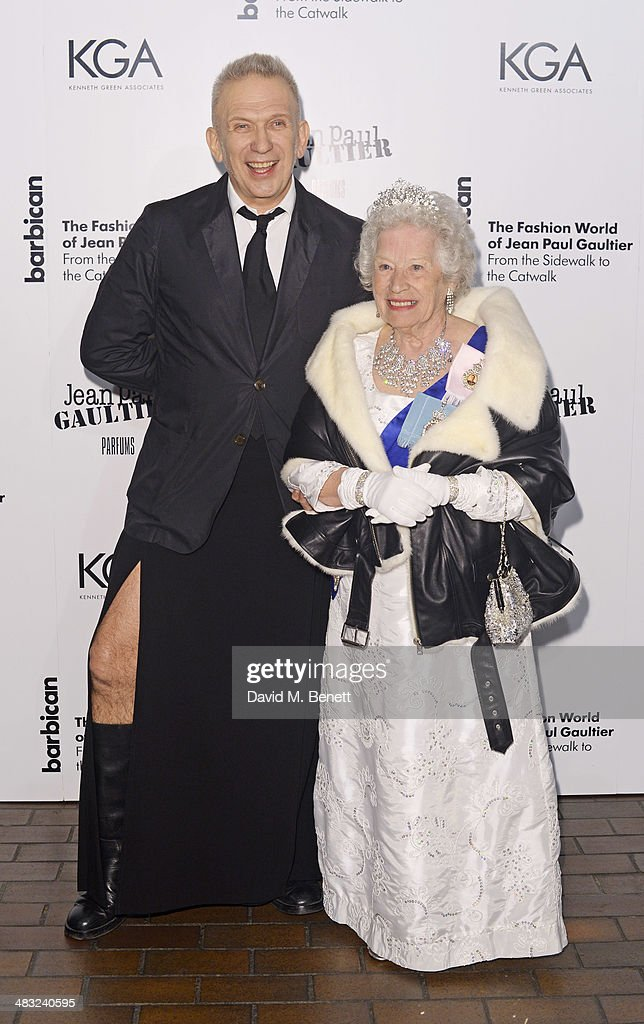 Jean Paul Gaultier (L) and a Queen Elizabeth II impersonator attend an exclusive reception for 'The Fashion World of Jean Paul Gaultier: From the Sidewalk to the Catwalk', showing at the Barbican Art Gallery from 9 April - 25 August 2014, held on April 7, 2014 in London, England.