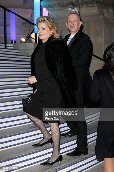 Jean Paul Gaultier and Catherine Deneuve attend the 'Jean Paul Gaultier' Exhibition at Le Grand Palais on March 30 2015 in Paris France