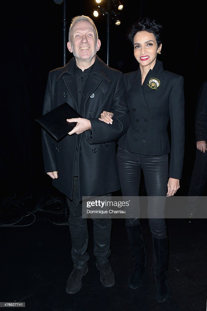 <a gi-track='captionPersonalityLinkClicked' href=/galleries/search?phrase=Jean+Paul+Gaultier+-+Modedesigner&family=editorial&specificpeople=4310036 ng-click='$event.stopPropagation()'>Jean Paul Gaultier</a> and <a gi-track='captionPersonalityLinkClicked' href=/galleries/search?phrase=Farida+Khelfa&family=editorial&specificpeople=4866090 ng-click='$event.stopPropagation()'>Farida Khelfa</a> attend the Saint Laurent show as part of the Paris Fashion Week Womenswear Fall/Winter 2014-2015 on March 3, 2014 in Paris, France.