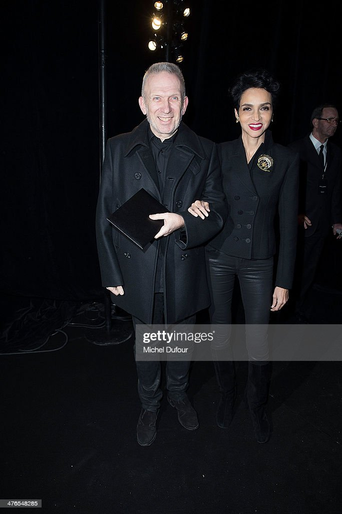 <a gi-track='captionPersonalityLinkClicked' href=/galleries/search?phrase=Jean+Paul+Gaultier+-+Fashion+Designer&family=editorial&specificpeople=4310036 ng-click='$event.stopPropagation()'>Jean Paul Gaultier</a> and <a gi-track='captionPersonalityLinkClicked' href=/galleries/search?phrase=Farida+Khelfa&family=editorial&specificpeople=4866090 ng-click='$event.stopPropagation()'>Farida Khelfa</a> attend the Saint Laurent show as part of the Paris Fashion Week Womenswear Fall/Winter 2014-2015 on March 3, 2014 in Paris, France.