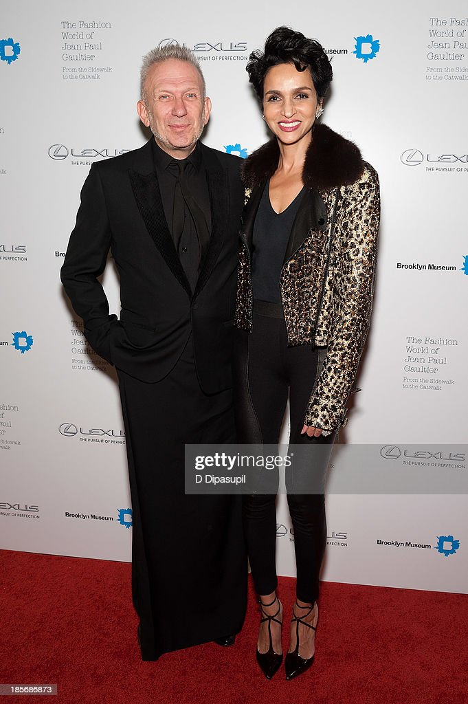 Jean Paul Gaultier (L) and <a gi-track='captionPersonalityLinkClicked' href=/galleries/search?phrase=Farida+Khelfa&family=editorial&specificpeople=4866090 ng-click='$event.stopPropagation()'>Farida Khelfa</a> attend the VIP reception and viewing for The Fashion World of Jean Paul Gaultier: From the Sidewalk to the Catwalk at the Brooklyn Museum on October 23, 2013 in the Brooklyn borough of New York City.