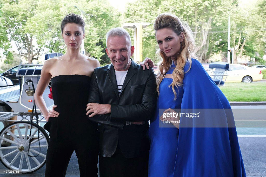 Jean Paul Gaultier arrives with models Andreja Pejic (R) and Alexandra Agoston (L) to the opening night of The Fashion World of Jean Paul Gaultier at the National Gallery of Victoria on October 16, 2014 in Melbourne, Australia.