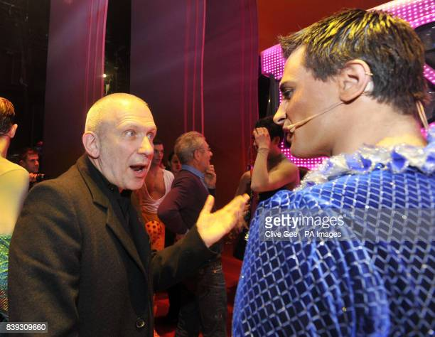 Jean Paul Gaultier meets with cast members of the cast of 'Priscilla Queen of the Desert' backstage at the Palace Theatre in central London