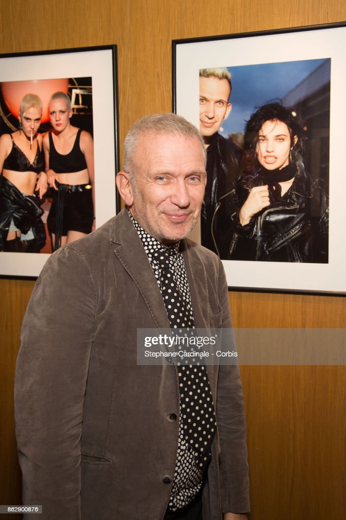 Jean Paul Gaultier pose in front of a pictures of him with Beatrice Dalle during the Simon Bocanegra and Philippe Morillon Exhibition, at la Galerie Du passage Pierre Passebon on October 18, 2017 in Paris, France.