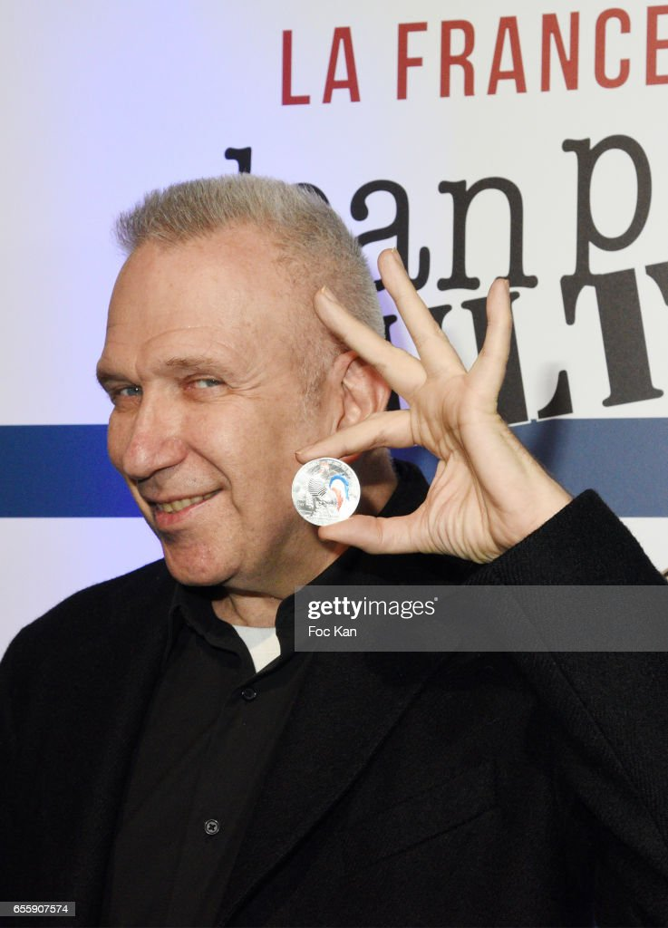 Jean Paul Gaultier poses with a coin he designed during 'France By Jean Paul Gaultier': Limited Coin Collection Press Preview At La Monnaie de Paris on March 20, 2017 in Paris, France.