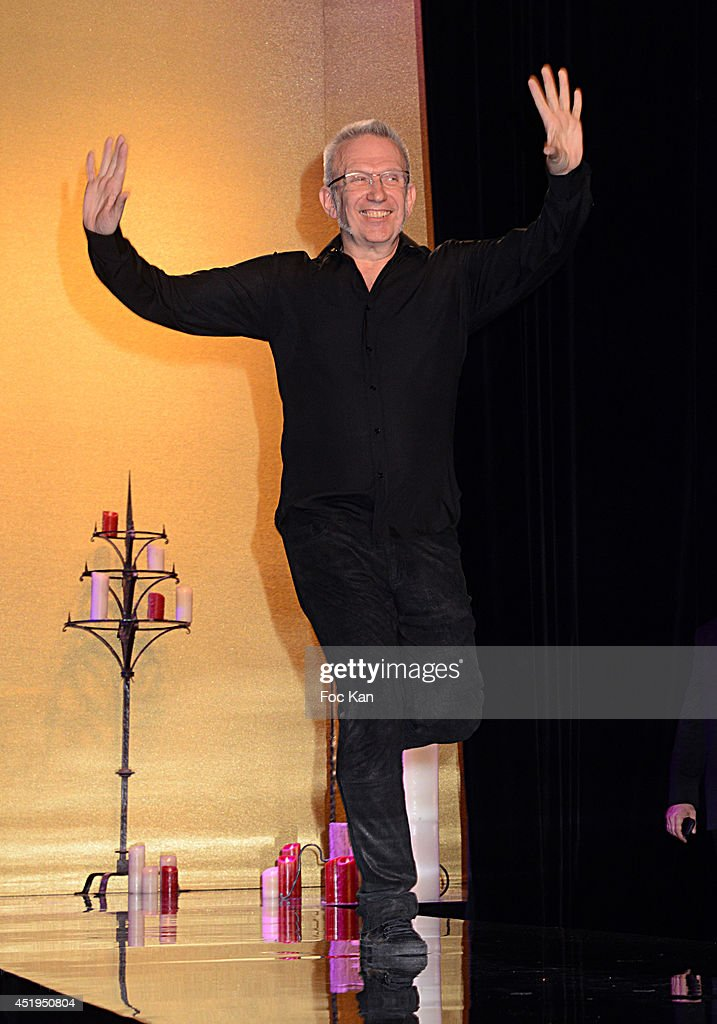 <a gi-track='captionPersonalityLinkClicked' href=/galleries/search?phrase=Jean+Paul+Gaultier+-+Fashion+Designer&family=editorial&specificpeople=4310036 ng-click='$event.stopPropagation()'>Jean Paul Gaultier</a> walks the runway during the finale of the <a gi-track='captionPersonalityLinkClicked' href=/galleries/search?phrase=Jean+Paul+Gaultier+-+Fashion+Designer&family=editorial&specificpeople=4310036 ng-click='$event.stopPropagation()'>Jean Paul Gaultier</a> show as part of Paris Fashion Week - Haute Couture Fall/Winter 2014-2015 at 325 Rue Saint Martin on July 9, 2014 in Paris, France.