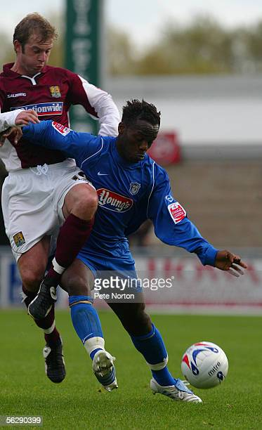 Jean Paul KamudimbaKalala of Grimsby Town holds off Martin Smith of Northampton Town during the Coca Cola League Two match between Northampton Town...