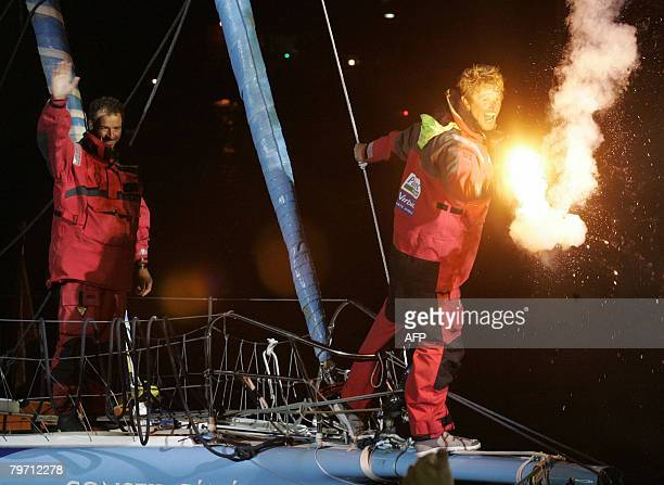 Jean Pierre Dick and Damian Foxal celebrate after arriving first in the Barcelona World Race at the port of Barcelona on February 11 2008 They were...