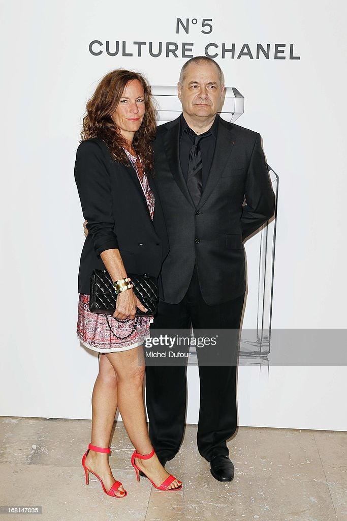 Jean Pierre Jeunet and wife attends the 'No5 Culture Chanel' Exhibition - Photocall at Palais De Tokyo on May 3, 2013 in Paris, France.