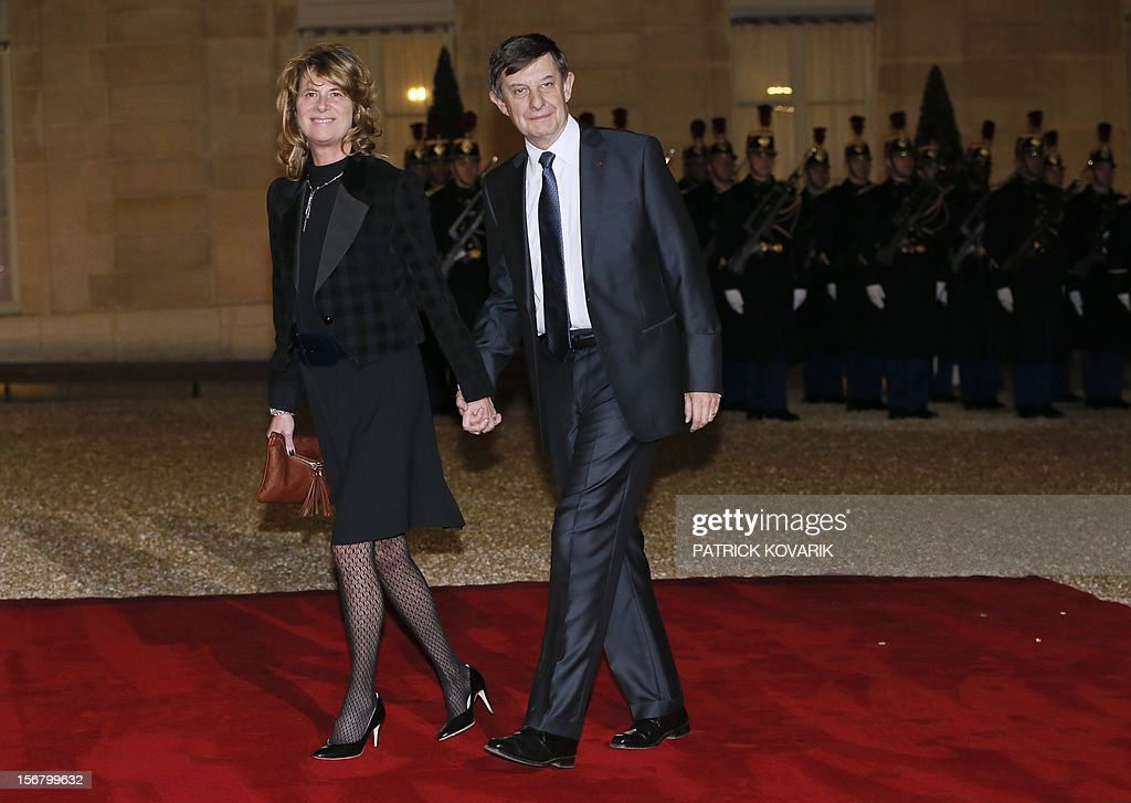 Jean Pierre Jouyet, president of the BPI (Banque Publique d'Investissement) and his wife Brigitte arrive at the Elysee palace in Paris, before a state dinner as part of a two-day state visit of Italian President Giorgio Napolitano, on November 21, 2012.