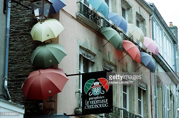 Jean Pierre Yvon and his umbrellas in Cherbourg France on May 19 2000