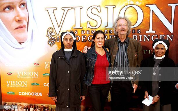 Jean Puetz and his wife Pina pose on the red carpet with nuns as they arrive for the premiere of the film 'Vision From The Life Of Hildegard Von...