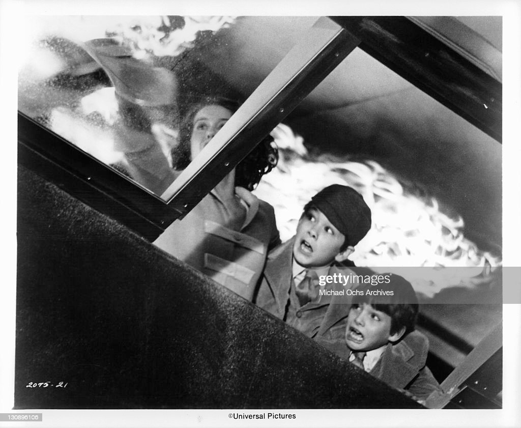 Jean Rasey John Scoot Lee and Stephen Manley are trapped by flames in a scene from the film 'The Hindenberg' 1975