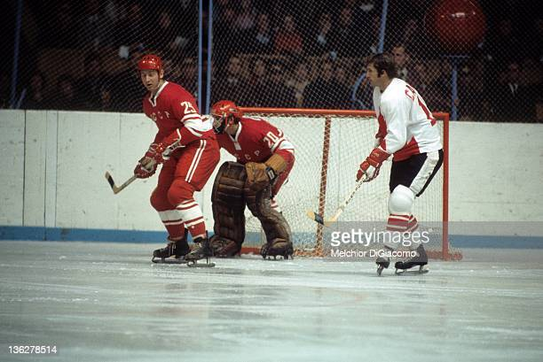 Jean Ratelle of Canada sets up in front as Yuri Liapkin and goalie Vladislav Tretiak of the Soviet Union defend the net during the 1972 Summit Series...