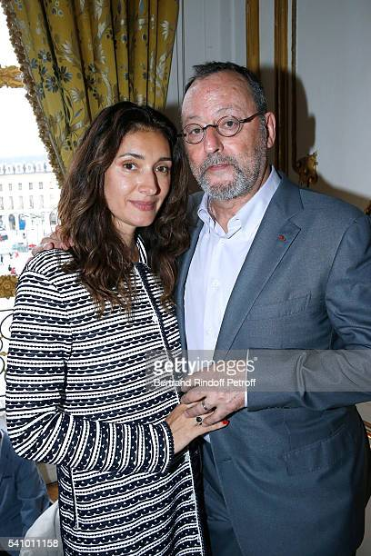 Jean Reno and his wife Zofia attend Levon Sayan receives Insignia of 'Commandeur de l'Ordre National du Merite' at Hotel d'Evreux on June 14 2016 in...