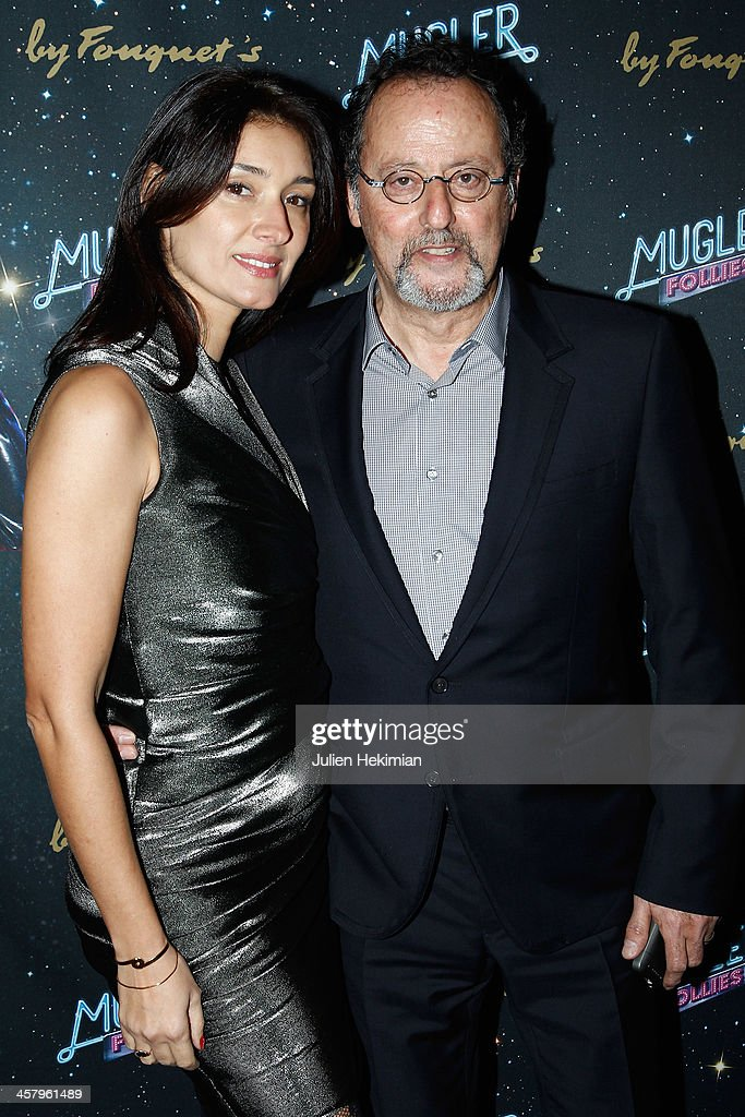 <a gi-track='captionPersonalityLinkClicked' href=/galleries/search?phrase=Jean+Reno&family=editorial&specificpeople=213522 ng-click='$event.stopPropagation()'>Jean Reno</a> and his wife <a gi-track='captionPersonalityLinkClicked' href=/galleries/search?phrase=Zofia+Borucka&family=editorial&specificpeople=586296 ng-click='$event.stopPropagation()'>Zofia Borucka</a> attend 'Mugler Follies' Paris New Variety Show - Premiere on December 19, 2013 in Paris, France.