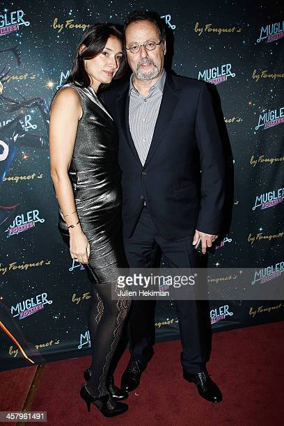 Jean Reno and his wife Zofia Borucka attend 'Mugler Follies' Paris New Variety Show Premiere on December 19 2013 in Paris France