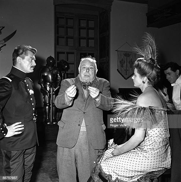 Jean Renoir French director and the actors Ingrid Bergman and Jean Marais during the shooting of ' Elena and the people ' On 1955 ADR136025