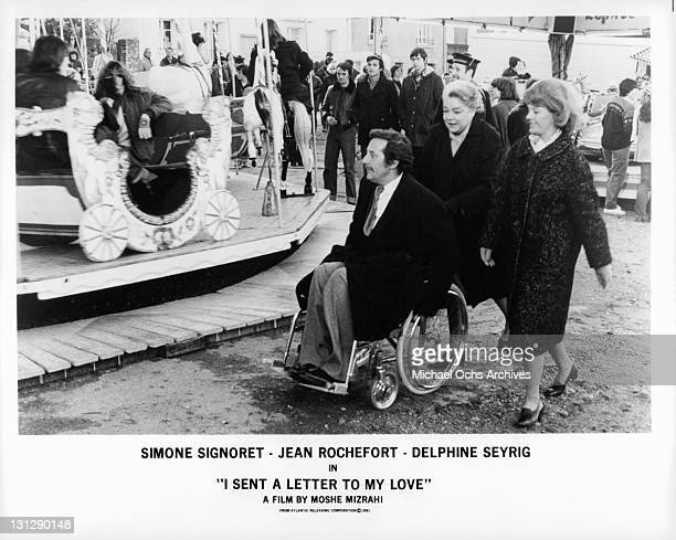 Jean Rochefort Simone Signoret and Delphine Seyrig going to the amusement park in a scene from the film 'I Sent A Letter To My Love' 1980