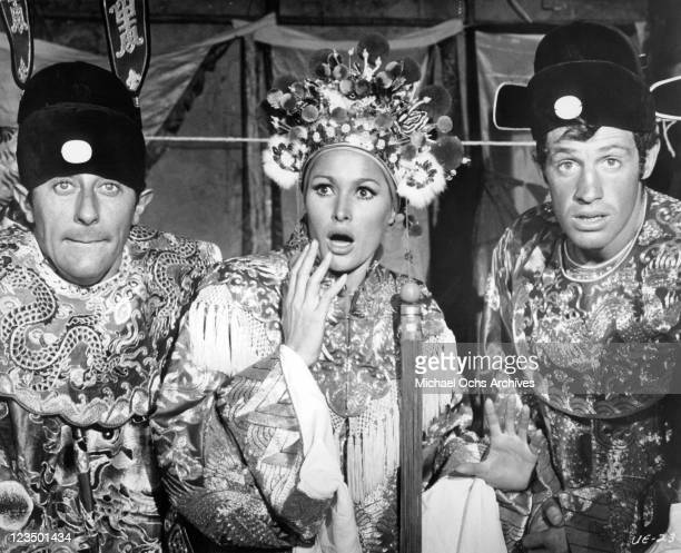 Jean Rochefort Ursula Andress and JeanPaul Belmundo all wearing Chinese mandarin robes in a scene from the film 'Up To His Ears' 1965