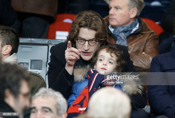Jean Sarkozy and his son attend the French Ligue 1 between Paris SaintGermain FC and FC Nantes at Parc Des Princes on January 19 2014 in Paris France