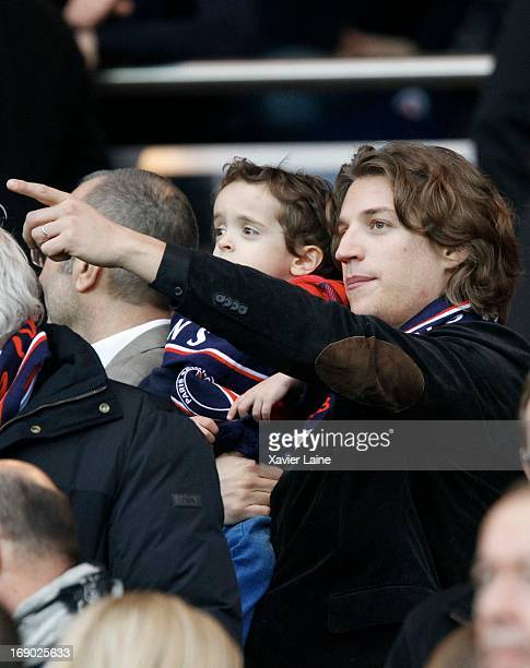 Jean Sarkozy and his son seen during the French League 1 between Paris SaintGermain FC and Stade Brestois 29 at Parc des Princes on May 18 2013 in...