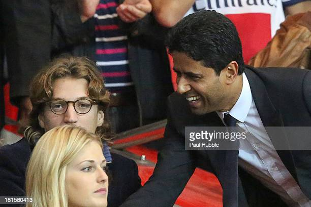Jean Sarkozy and Nasser AlKhelaifi are seen during the Paris Saint Germain FC vs AS Monaco FC at Parc des Princes on September 22 2013 in Paris France