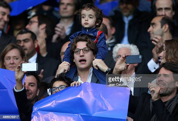 Jean Sarkozy holding his son Solal Sarkozy attends the french Ligue 1 match between Paris SaintGermain FC and Stade Rennais FC at Parc des Princes...