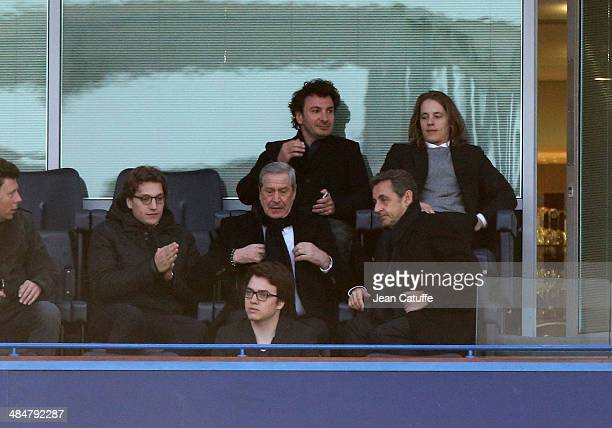 Jean Sarkozy JeanClaude Darmon Nicolas Sarkozy above them Michael Youn and Pierre Sarkozy attend the UEFA Champions League quarter final match...