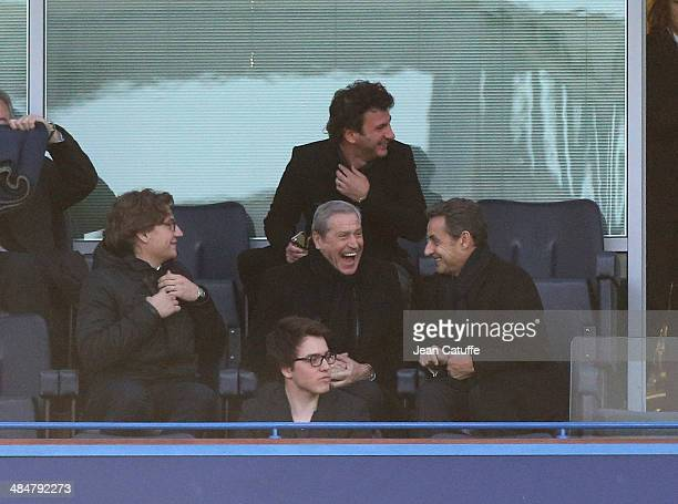 Jean Sarkozy JeanClaude Darmon Nicolas Sarkozy and above them Michael Youn attend the UEFA Champions League quarter final match between Chelsea FC...